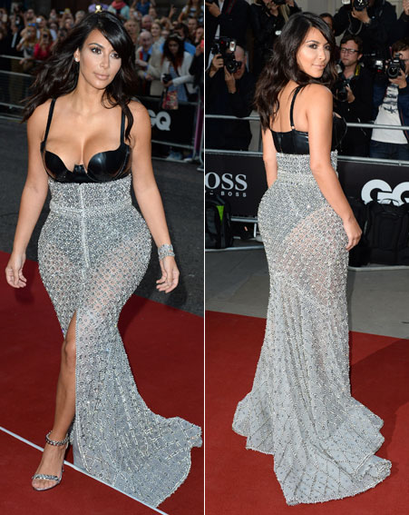 Kim Kardashian-West at the 2014 GQ Mens Quarterly Awards wearing a latex bodysuit by Atsuko and a metal gun sheer skirt by Ralph & Rosso