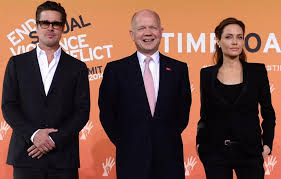 Angelina Jolie at the 2014 End Sexual Violence Against Women in Conflict Global Summit with her husband and actor, Brad Pitt and  Secretary of State, William Hague