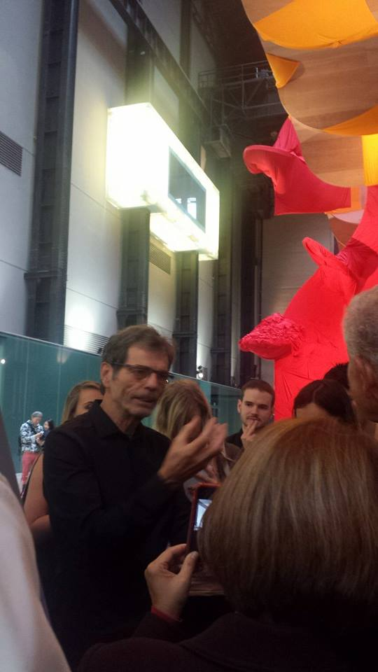 Richard Tuttle explains his work to the press